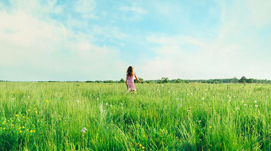 Woman in Tall Grass Field